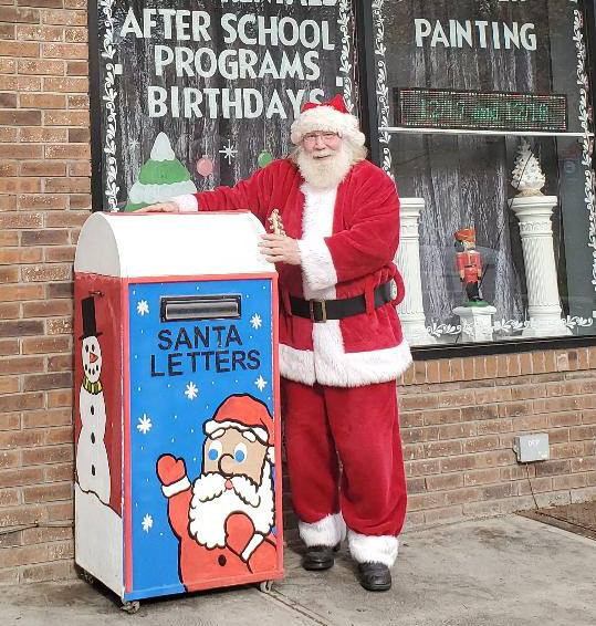 Santa with his Letters to Santa Mailbox