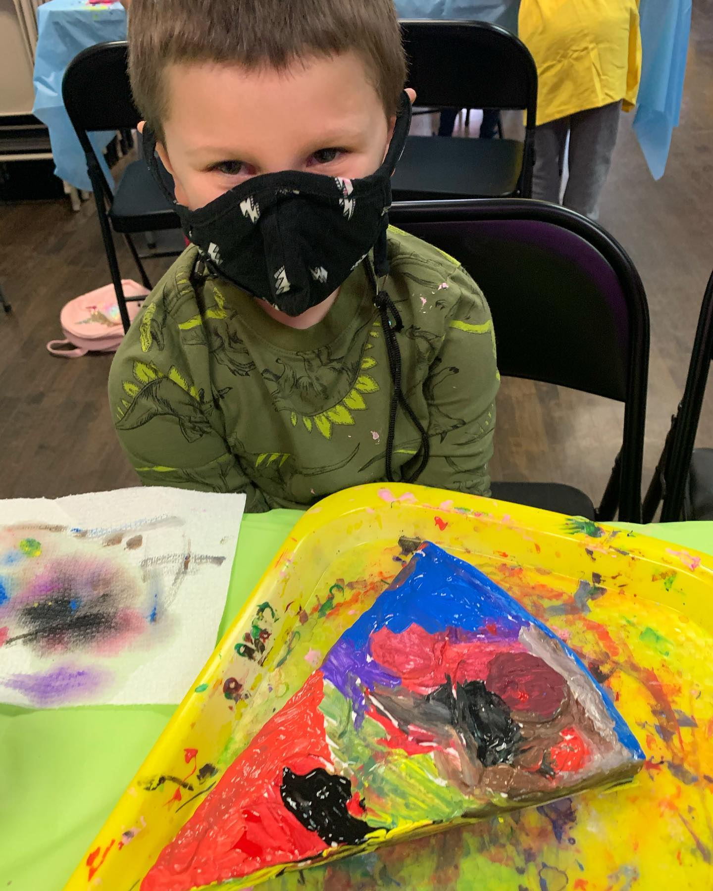 Boy in mask with pizza plaster painting