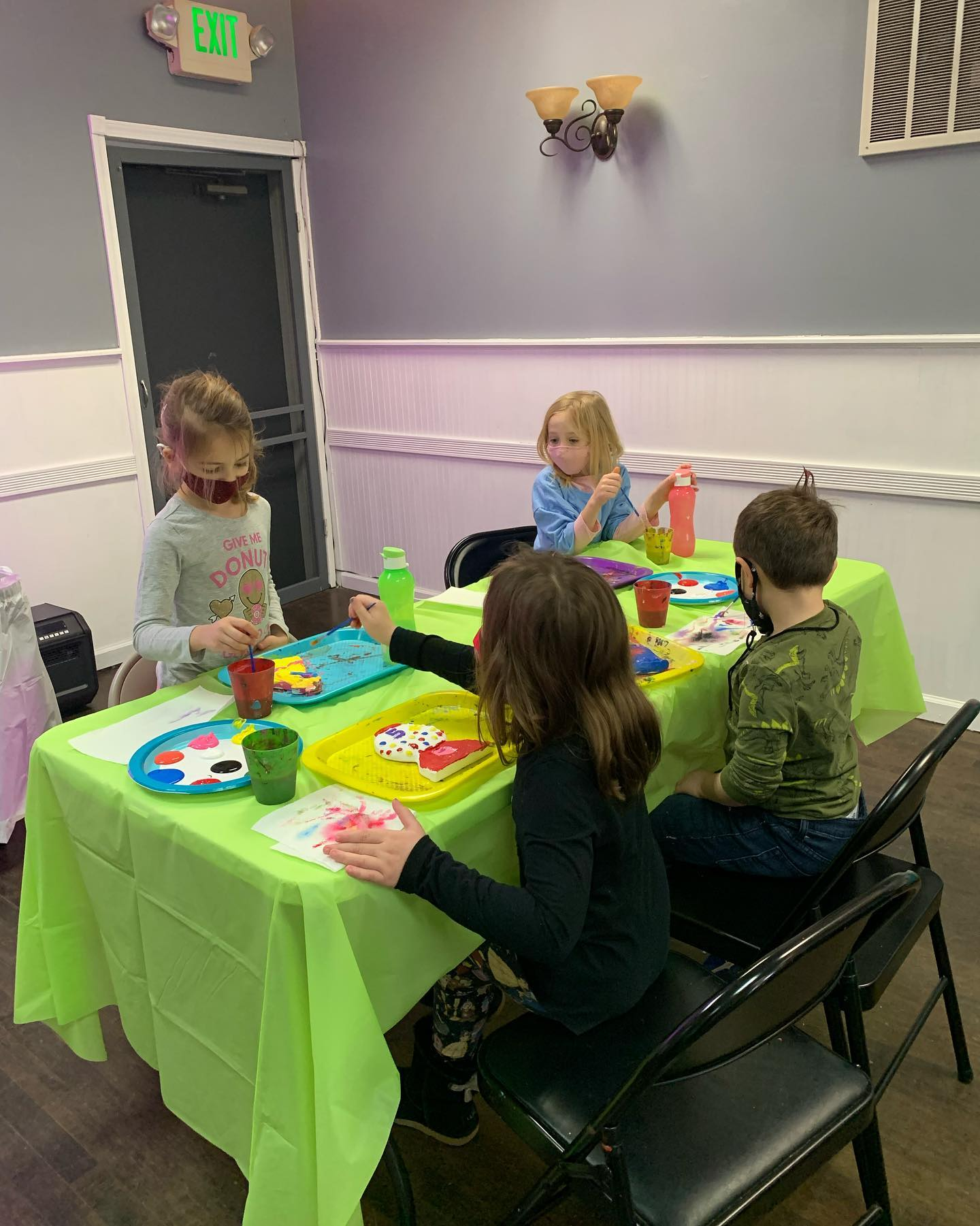 Kids painting during plaster paint party