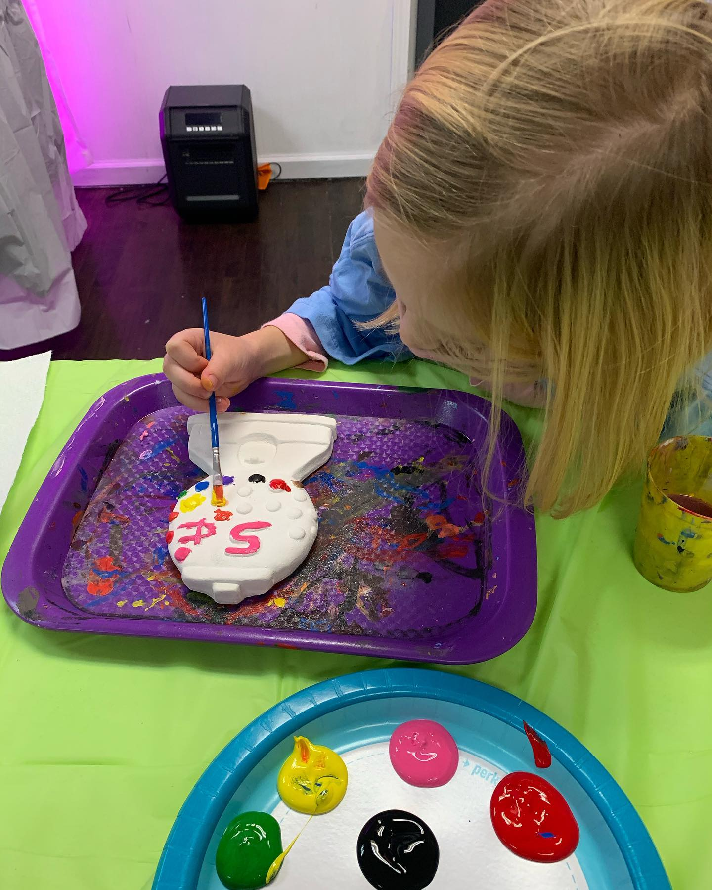 Girl painting gumball machine plaster party piece