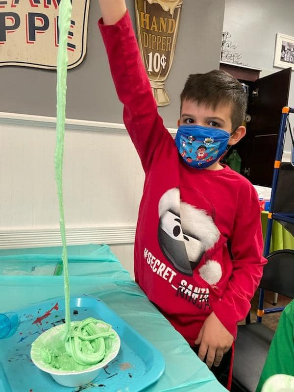 Boy in mask at slime party