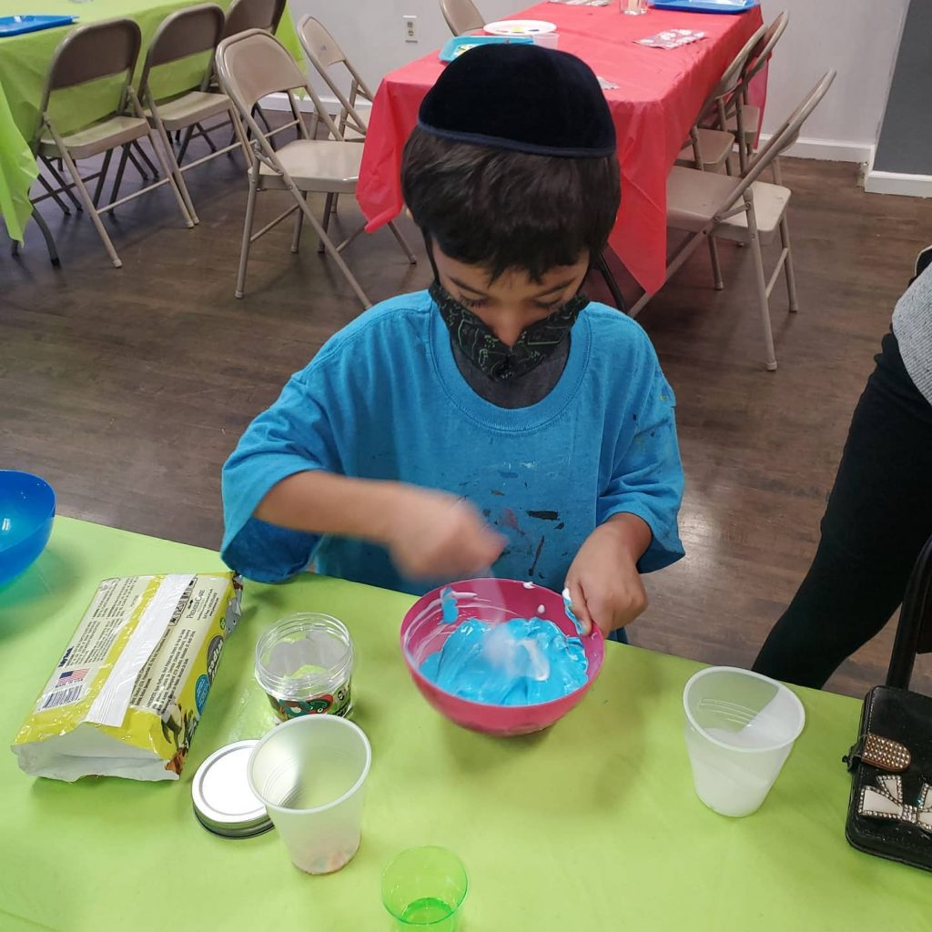 Boy in mask making slime