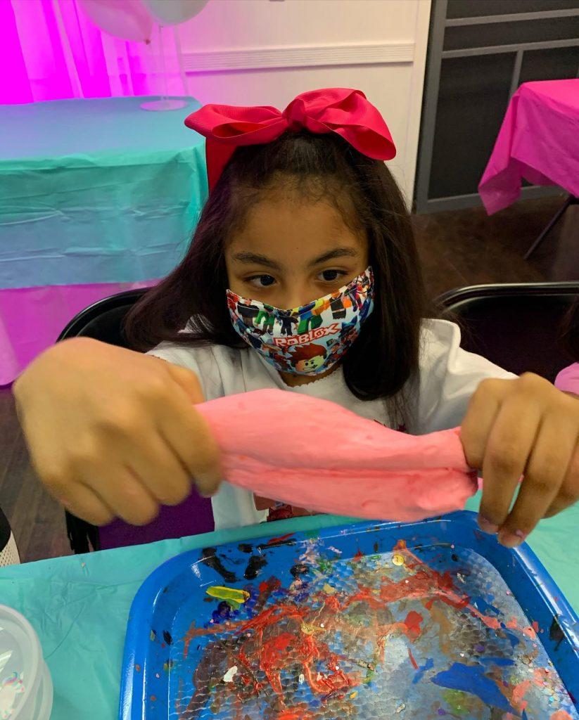 Girl in mask making slime