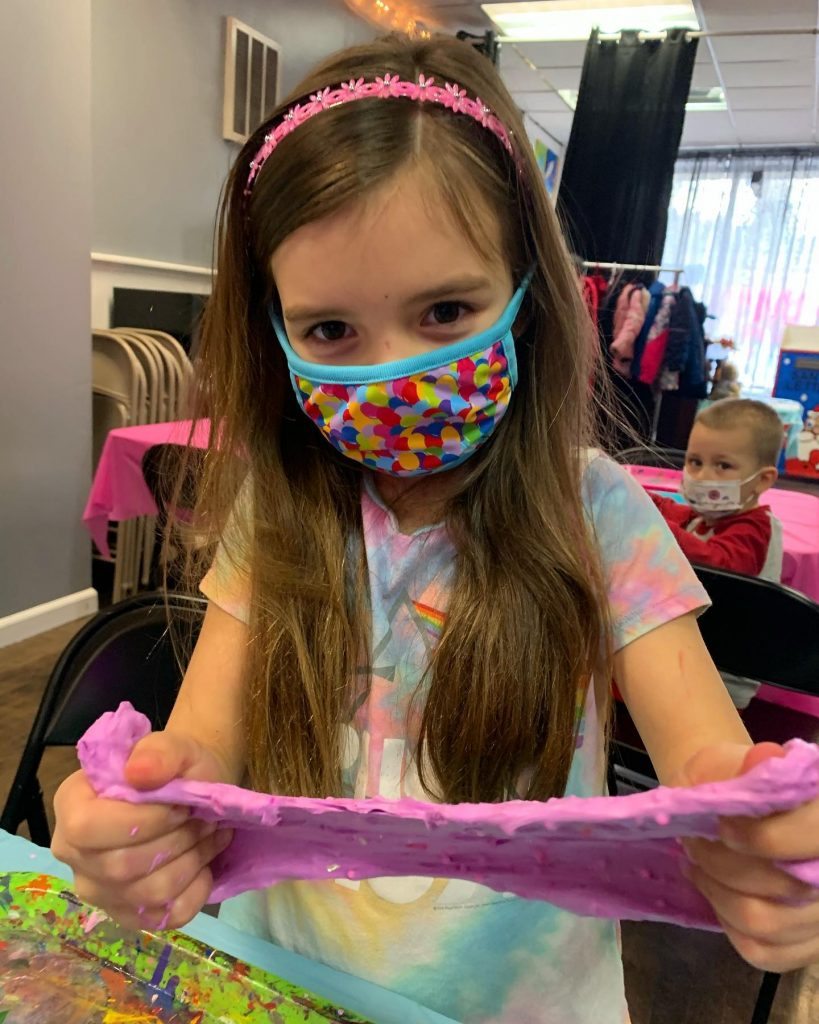 Girl in mask stretching slime