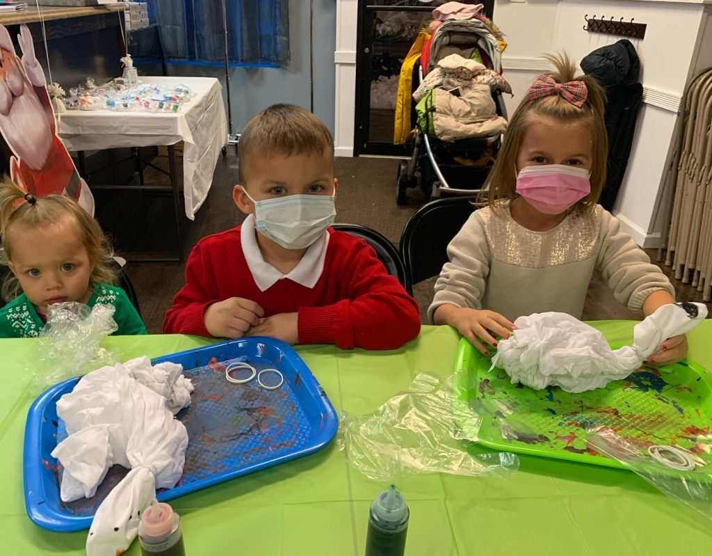 Children in masks getting ready for tie dye party