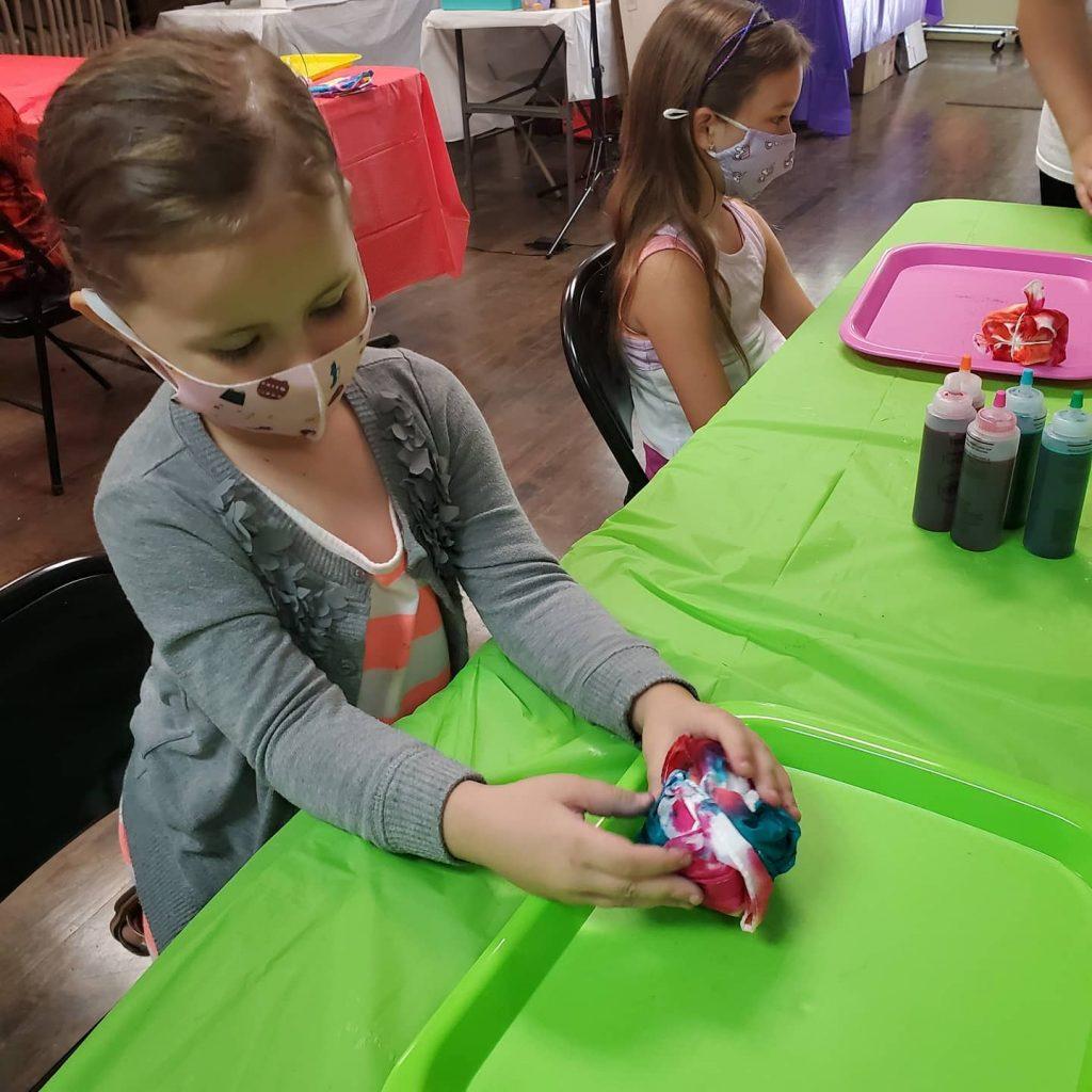 Girl making tie dye at A Sprinkle of Fun