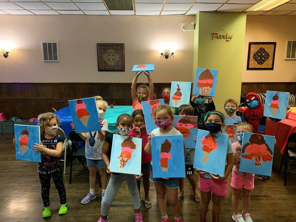 Children in masks showing ice cream canvas paintings
