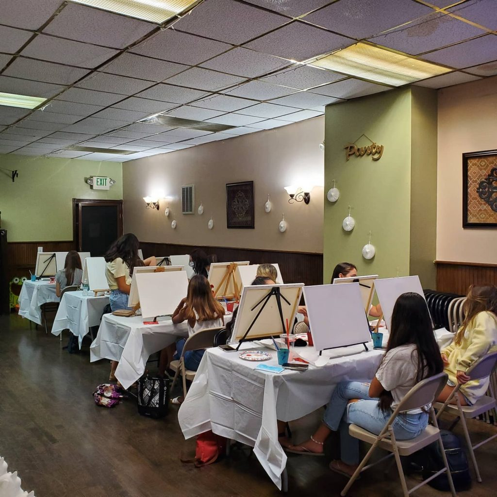 Young ladies canvas paint and sip party