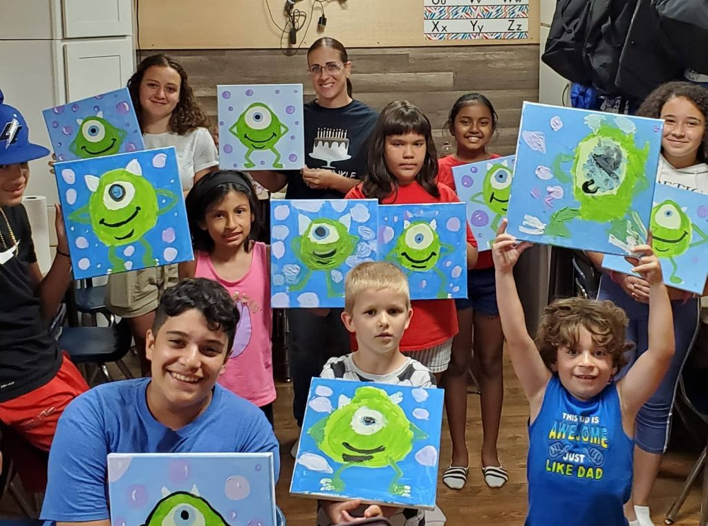 Kids showing Monster themed canvas paintings