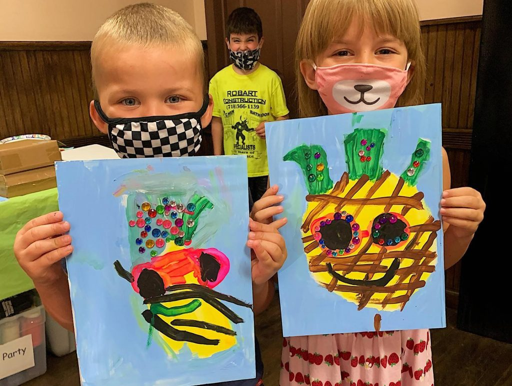 Kids in masks showing pineapple theme canvas art